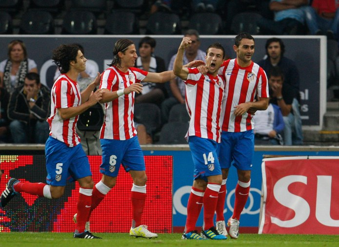 Atletico Madrid's Gabi celebrates his goal against Guimaraes with teammates during their Europa League playoff second leg soccer match at Afonso Herinques stadium in Guimaraes