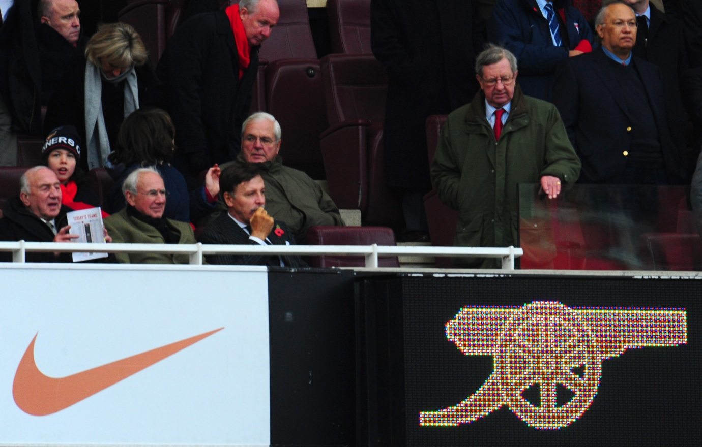 Arsenal majority shareholder Stan Kroenke in his seat as Chairman Peter Hill Wood walks down to occupy his seat. Kroenke was not in his seat for the second half